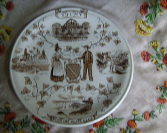 Castelroux Porcelain de France souvenir plate,Vichy 'Reine des Villes d'Eau'(Queen of spa towns), brown and white,showing local attractions.