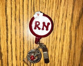 Retractable registered nurse badge reel.