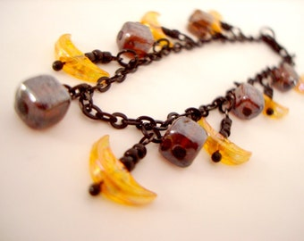 Crescent Moon Charm Bracelet yellow iridescent moons with iridescent tortoise square beads and black chain