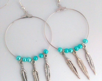 Handmade earrings with pearls and feathers
