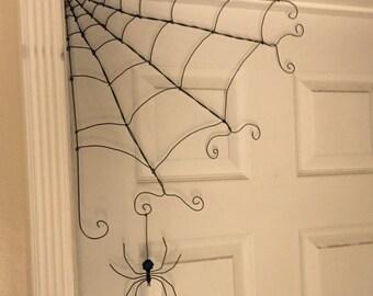 Corner wire spider web