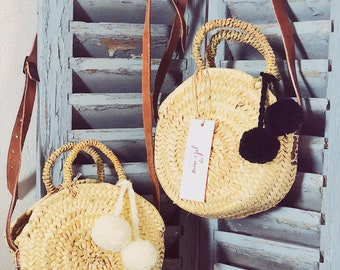 The baskets round tassels leather handles