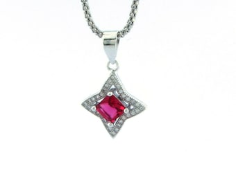 Star pendant with fuchsia central zircon and surrounded by white cubic zirconia Garndezza 1.5 x 1.5 Hypoallergenic