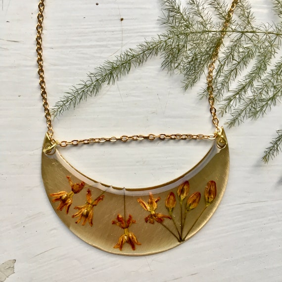 Butterfly weed flower brass crescent necklace