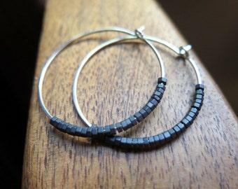 black earrings. hammered silver hoops. geometric jewelry.