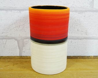 Small Red vessel with Black glaze inside.