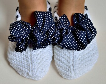Hand knitted women's slippers with decorative ribbons