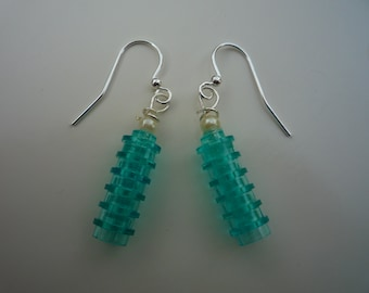 Stunning lego® brick turquoise dangle earrings:6 translucent round pieces. Finished with small pearlesque bead and silver plated hook