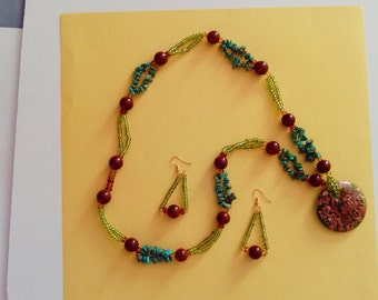 Olive seed beads mixed with brown and green glass beads.
