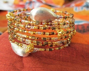 Golden amber GYPSY wide wrap around bangle bracelet. Gold, amber and Silver toned  beads. 4 cm wide cuff bracelet