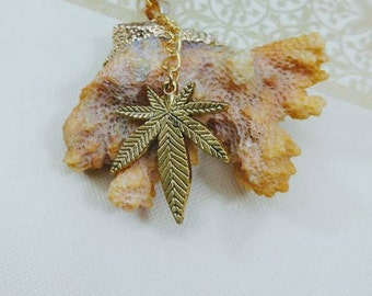 Large Beach Coral Cannabis Leaf Necklace on Heavy Chain.