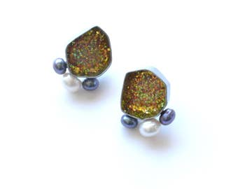geometric stud earrings in chrome and gold sparkle, geode post earrings with white and black pearls, glitter statement earrings