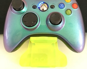 Brand new Xbox 360 controller custom painted in colour changing paint,Green-Purple. Plus custom blue LED mod. Boxed.