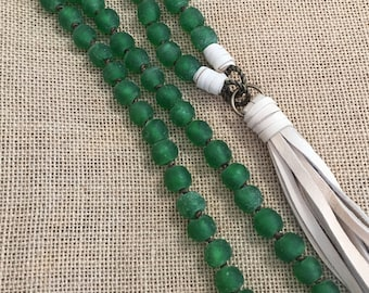 Green knotted African glass beads with beige deerhide tassel