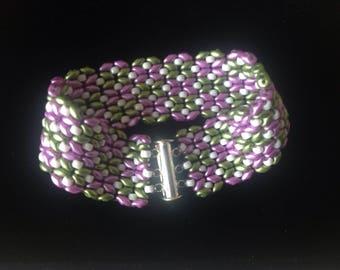 Easy wear bracelet/cuff with magnetic slide fastener.