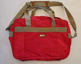 Jaguar Carry-On Travel Bag. Luggage. Overnight Bag. Red and tan. Awesome condition. 3 pockets.