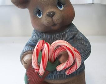 Ceramic Christmas reindeer boy holding Christmas stocking, candy canes