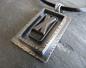 A Kiss is Just a Kiss Letterpress Pendant in Sterling Silver