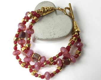 Pink and Crimson Czech Glass, Fancy Jasper and Gold-plate beaded, three-strand Bracelet