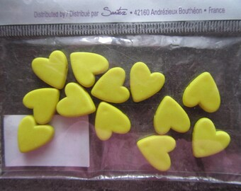 Heart shaped bag of 12 beads in yellow color resin