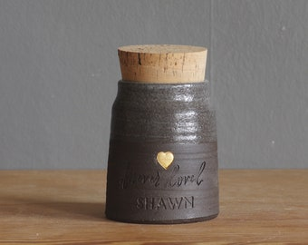 brown pottery urn for ashes. personalized and customized. Unique custom pet urn or urn for human cremains. brown, cloudy and gold