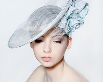 Sinamay saucer with double full blown silk rose spray and veiling perfect for a wedding/ the Melbourne Cup.