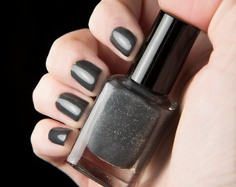 Heads or Tails nail lacquer - Charcoal grey with flecks of silver - The Columbia Collection - .45oz/13.2mL