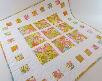 Quilted Square Table Topper in bright pastel Kaffe Fassett prints adds colorful beauty to your home!