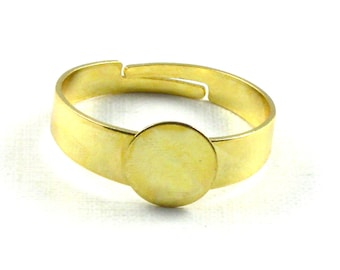 10 gold RING blanks with 8mm pad. Adjustable for ring size 7 and larger. Lead free, nickel free and cadmium free