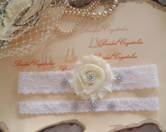 FREE SHIPPING-Wedding Garter set - Flowers ivory on a White  Lace with rhinestone crystals