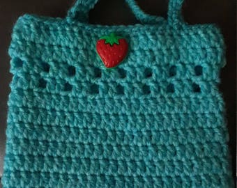 A cute mini-bag in aqua blue with strawberry button