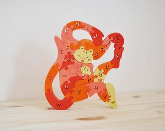 Puzzle wooden monkey mother and her baby in the alphabet