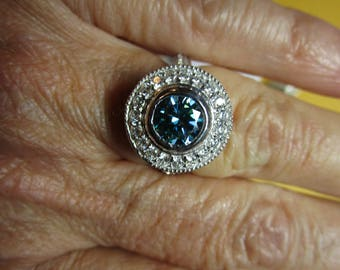Ladies 1ct blue moissanite halo ring in sterling with accents