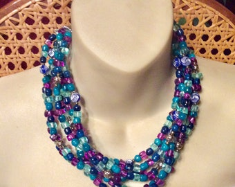 Blue purple turquoise colored beads beaded multi strand necklace.