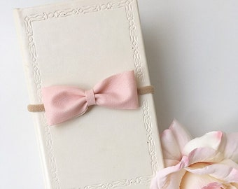 Baby and girls pastel soft pink faux leather classic bow nylon headband or hair clip