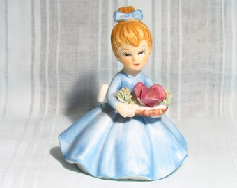 June Porcelain Figurine In A Blue Dress - By Napcoware - 3-1/2 Inches Tall And 2-1/2 Inches Wide - C-8614 Stamped On Bottom.