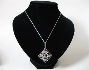 "Sterling Silver Modernist Diamond Shaped Pendant on a 18"" chain"