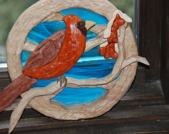 intarsia male cardinal on branch with stain glass background