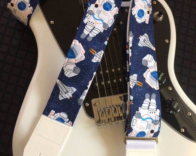 Retro spaceman guitar strap // cool out of this world 1960s nostalgia // spacesuit, space shuttle, satellite indigo star field background