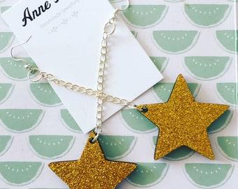 Large gold glitter STAR laser cut dangle earrings tacky festival wear kitsch retro style 5cm stars
