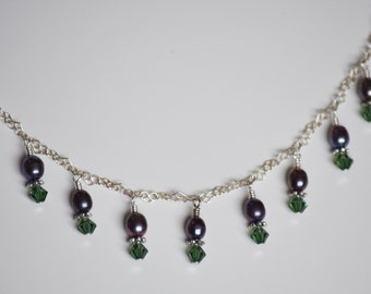 The Camilla - tweezer nipple clamps on sterling silver chain with purple pearls and erinite Swarovski crystals.
