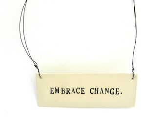 embrace change   ...   hanging porcelain sign