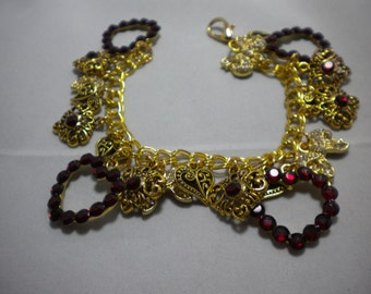 Charm bracelet with red crystals for that extra sparkle.