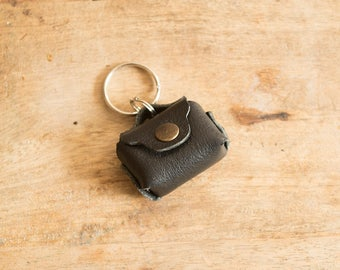 Door tokens made of genuine leather. Keychain shaped bag.