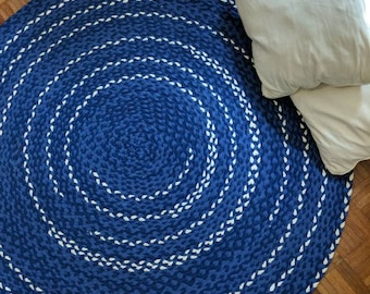 Indigo blue braided rug with off white accents