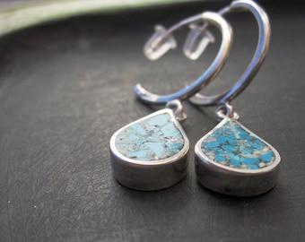 Silver charm hoop earrings with teardrop dangle of Turquoise inlay