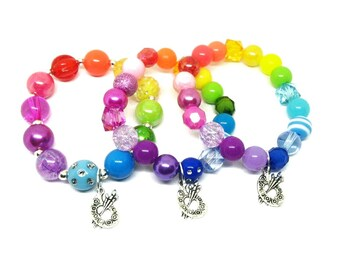 Girl's art paint party favors bracelets in organza bags with special birthday girl bracelet!