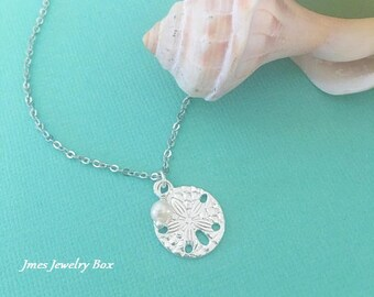 Silver sand dollar necklace with freshwater pearl
