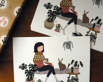 """Carte postale """"Un lapin à la maison"""""""