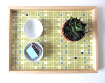 Wooden tray mosaic background. gift idea